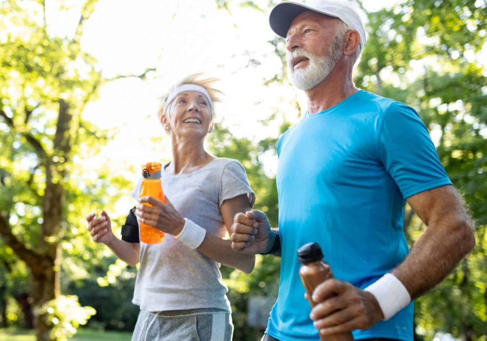 Social-Older-man-and-woman-jogging-in-a-park-700h